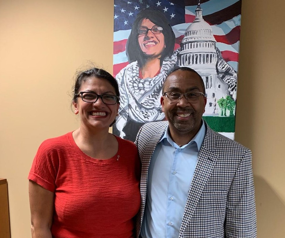 a picture of James Dennis and Rashida Tlaib